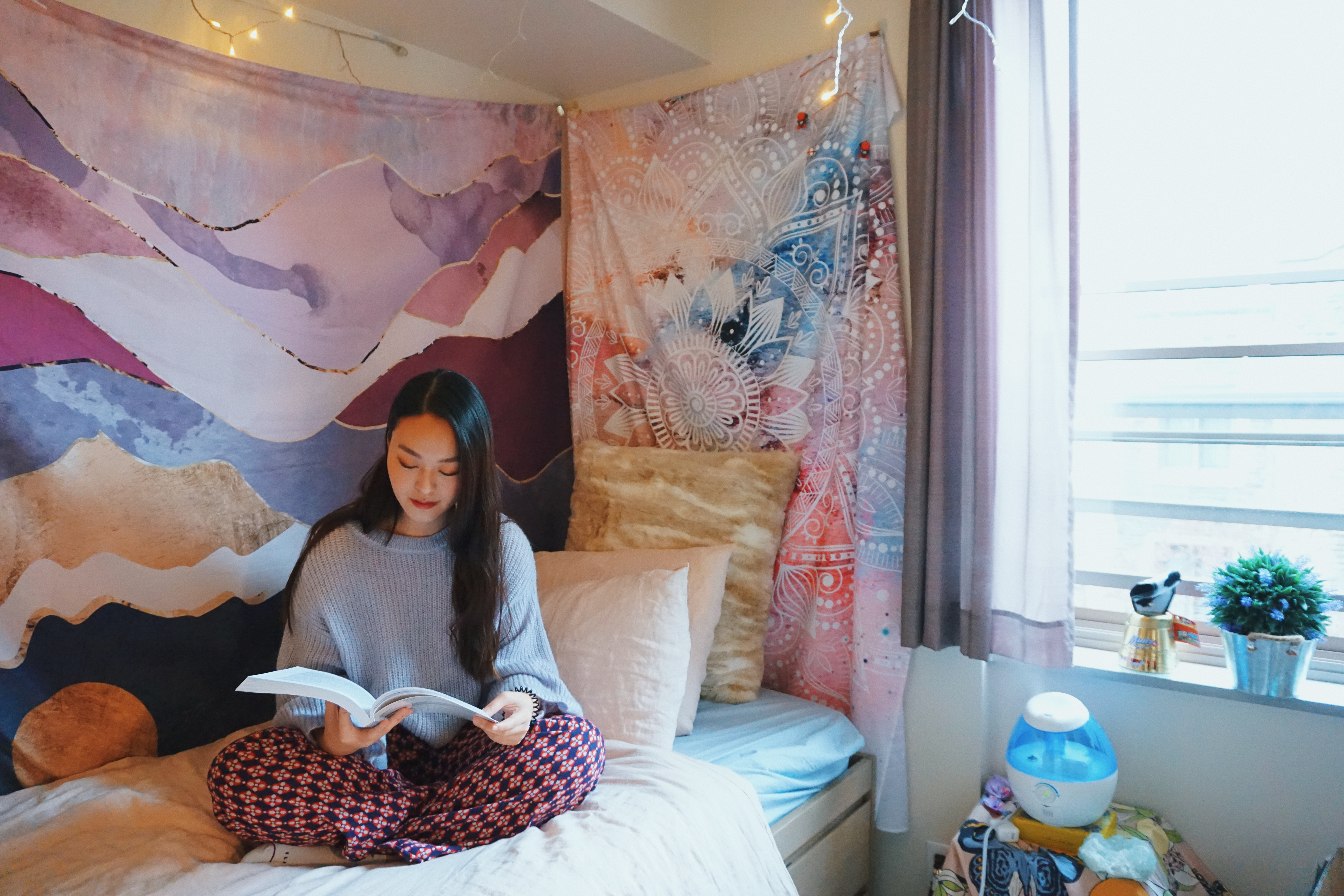Student reading in her residence room