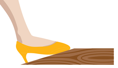 In this illustration, a woman's feet rest atop a footrest.