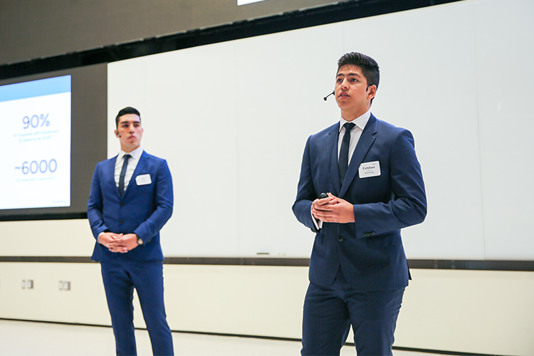 Esteban Arellano (right) and Juan Egas of Brainloop deliver a presentation at the 2019 Hatchery Demo Day.