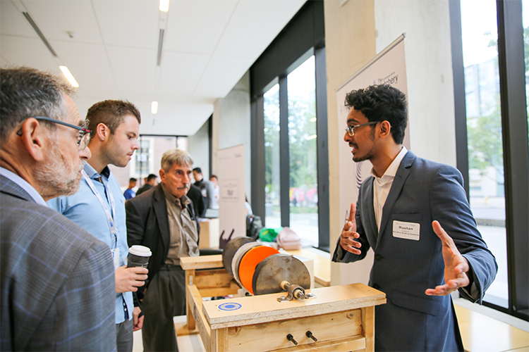 Roshan Varghese of Aeroflux speaks to attendees at the Entrepreneurship Hatchery's 2019 Demo Day competition.