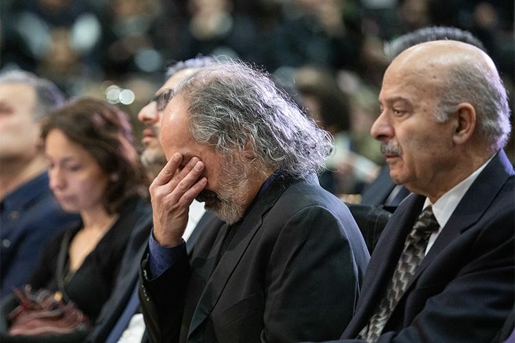 U of T Mississauga Professor Mohamad Tavakoli-Targhi wipes tears from his eyes as former Ontario cabinet minister Reza Moridi looks on.