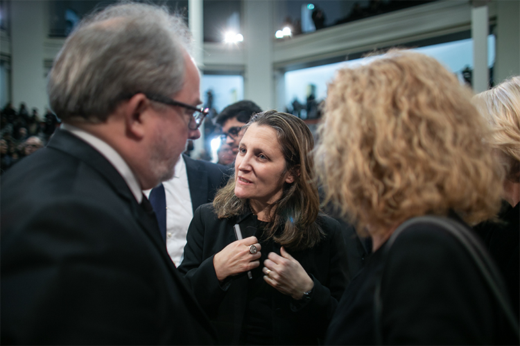 Deputy Prime Minister Chrystia Freeland speaks with David Palmer, U of T 's vice-president, advancement, and Cheryl Regehr, vice-president and provost.