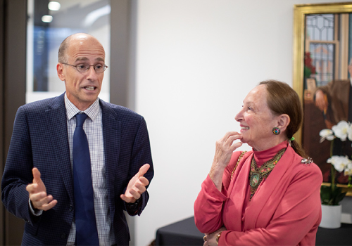 Edward Iacobucci, dean of the Faculty of Law, speaks with Justice Abella.