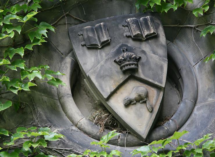 U of T statue of university crest