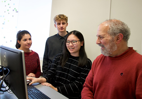 Brad Bass with three ROP students in front of a computer