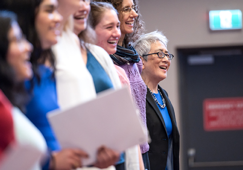 Carol Chan sings with the choir during her installation ceremony at Woodsworth College.
