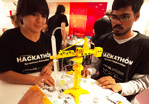 Martha Flores and Abhinav Anand of team Atoms Family put the finishing touches on their award-winning robotic crane