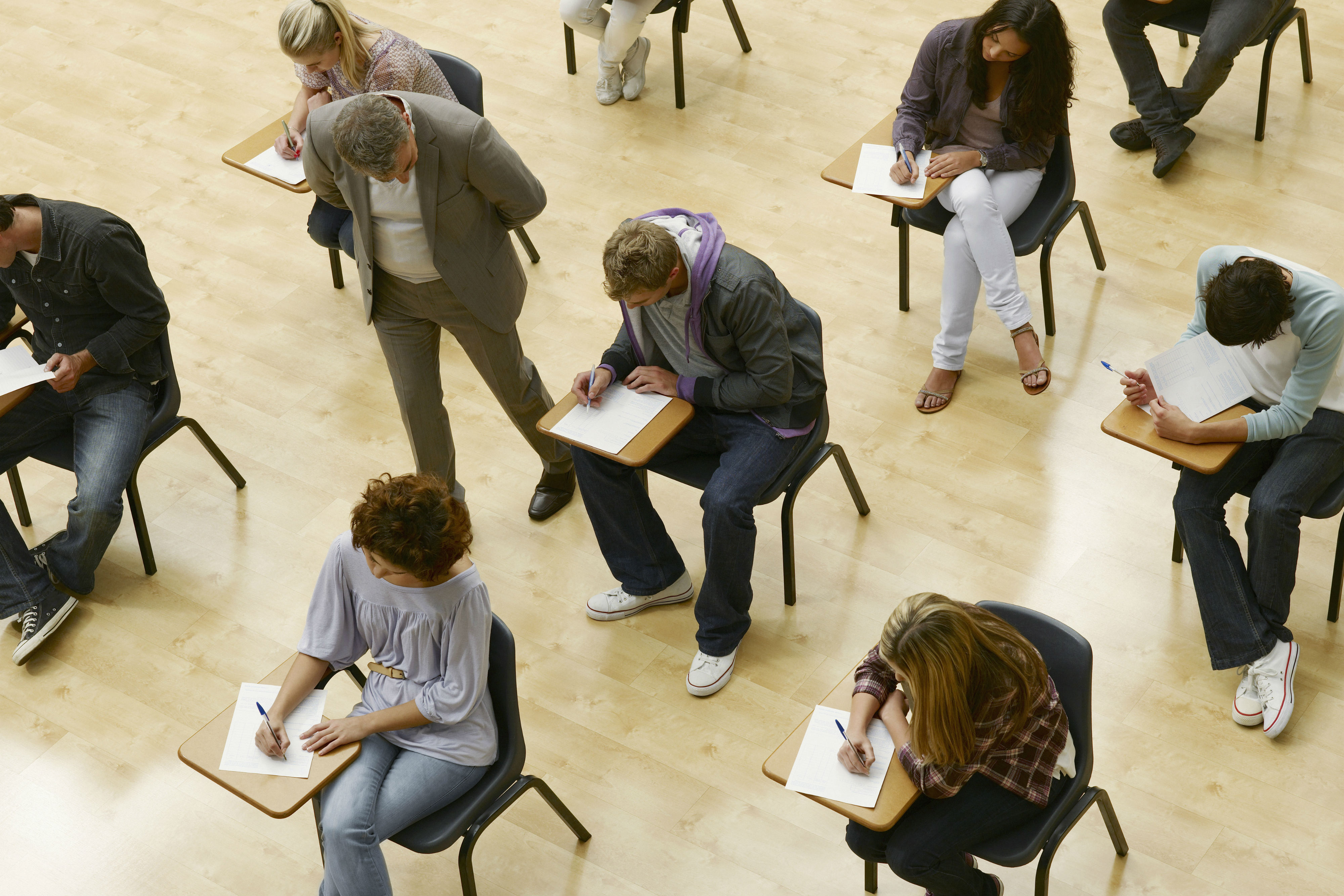 Overhead photo of students writing exams