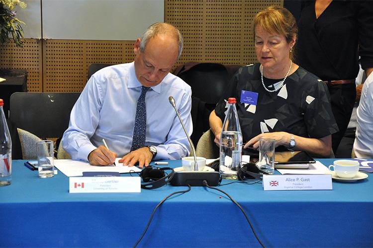 U of T President Meric Gertler signs the final declaration