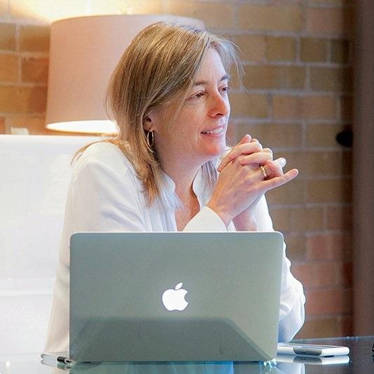 Julie Bristow sitting at a desk