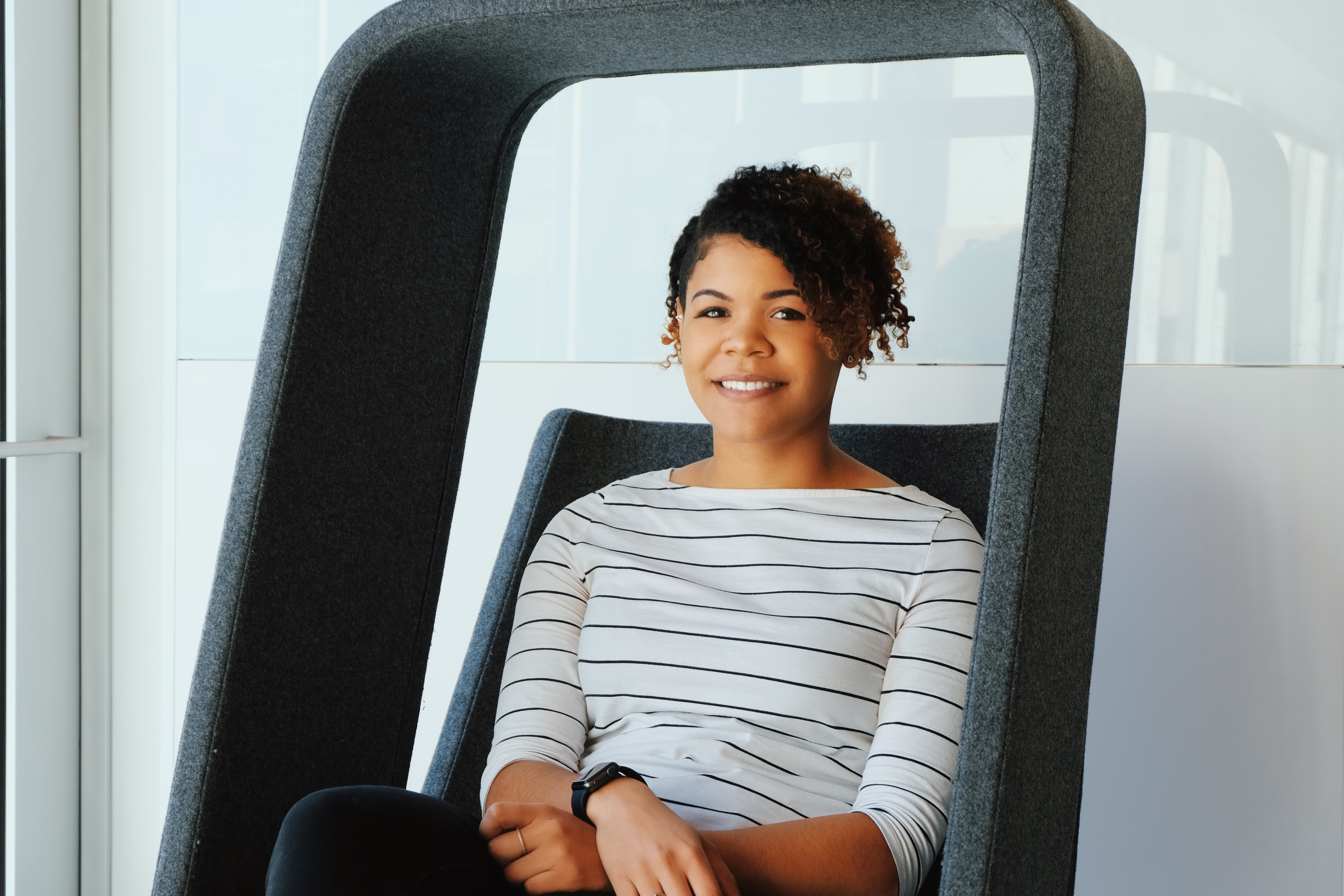 Portrait of student sitting in a chair
