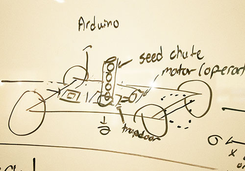 Concept art and an illustration of a seed chute that looks like a cannon on wheels.