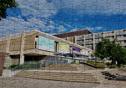 A picture of Sidney Smith building cut into puzzle pieces.