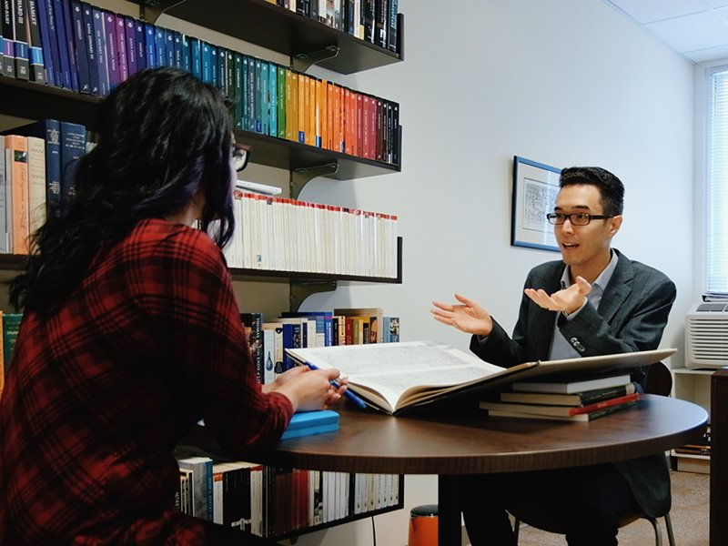 photo of a Student chatting with a faculty in an office