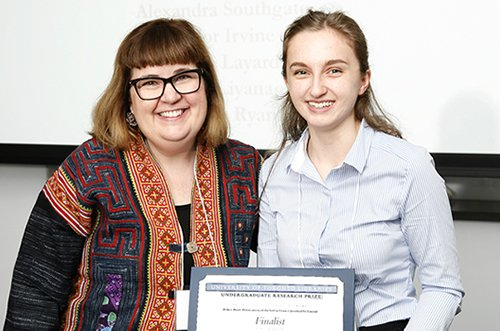 Photo of student receiving an award from a faculty member