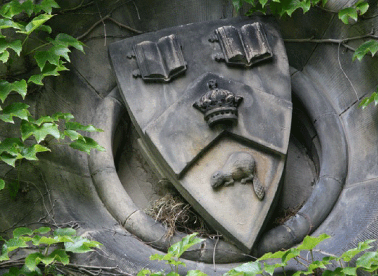 St. George campus, close-up of crest on an exterior wall.