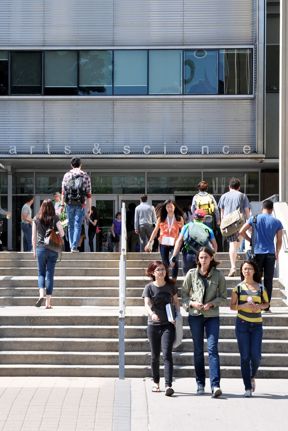 A group of students in front of Sidney Smith stairs.