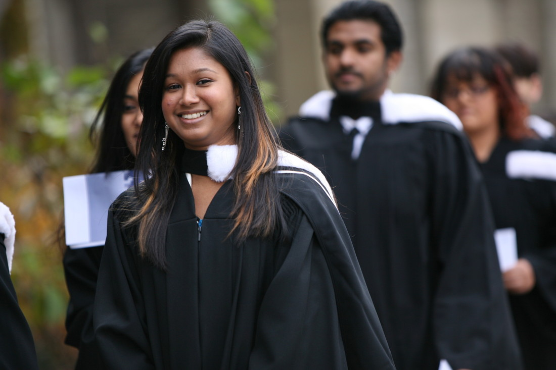 Photo of female graduand in the convocation procession