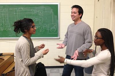 Professor Steve Engels discusses class materials with students