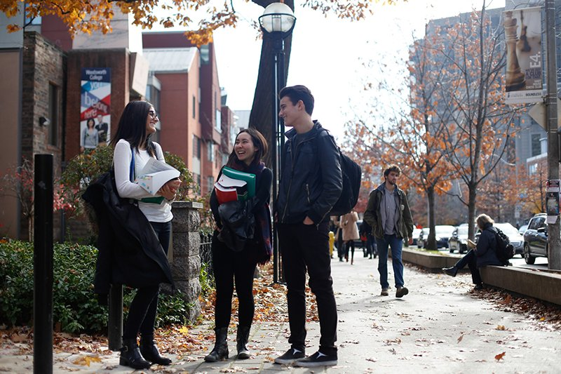 group of students chatting on St George Street