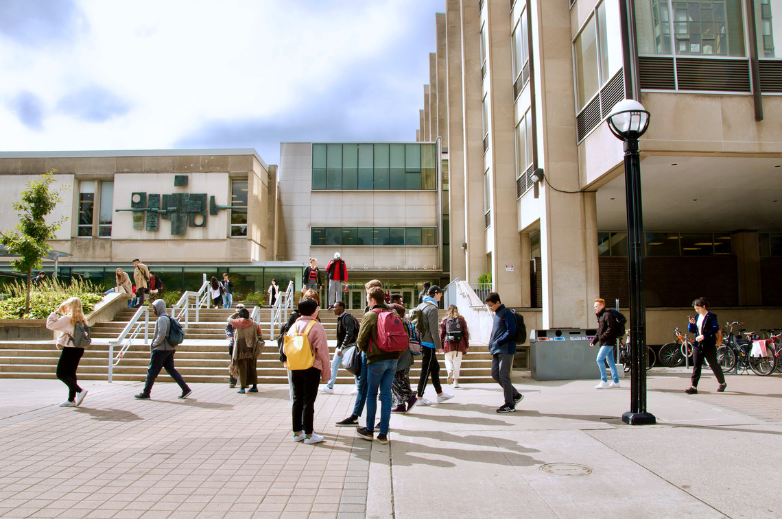 Students talking in front of Sidney Smith Hall