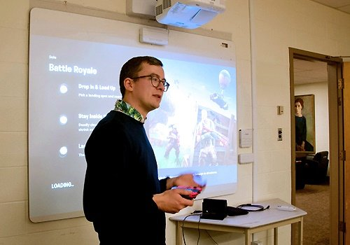 Assistant Professor Felan Parker engaging students with a lecture about video games.