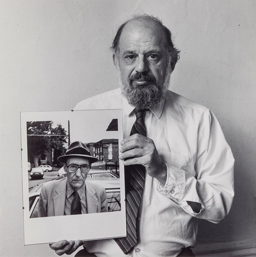 Allen Ginsberg with his own portrait of Burroughs