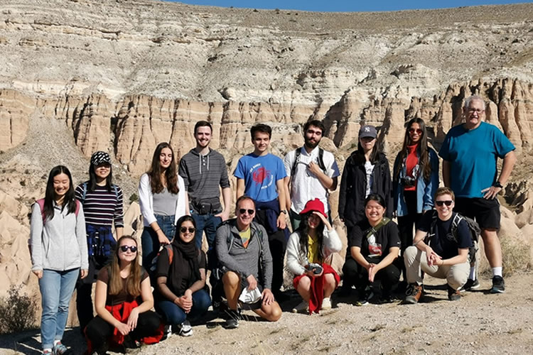 Group shot of the students on a cliff