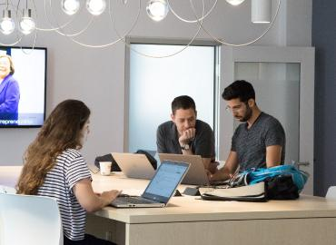 students working in common study space