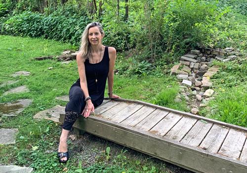 Lucinda Widdrington's sitting in a garden.