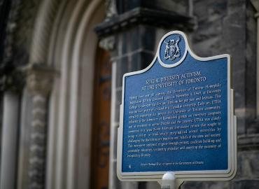 A blue and gold plaque highlighting the story of sexual diversity within the University.