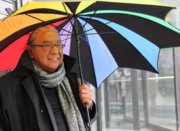 Amos Key Jr. holding a colourful umbrella