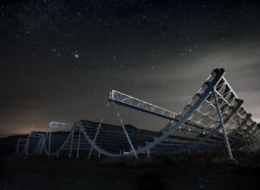 A metal structure under a starry night.