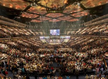 The interior of a megachurch, packed with thousands of parishioners