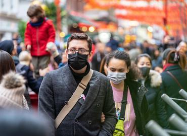 people in medical masks on street