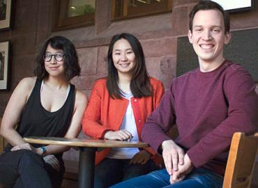 Master of Global Affairs students Gabrielle Lim, Vanessa Ko and Tim Dutton, sitting around a table.