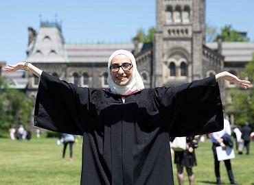 Noura al Jizawi standing in front of University College at Convocation
