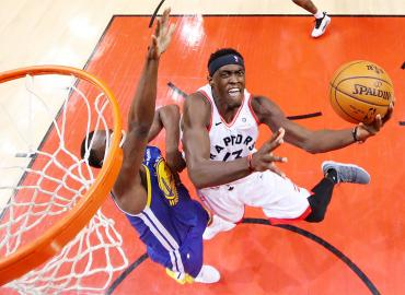 Toronto Raptors' forward Pascal Siakam attempts a lay up against the Golden State Warriors in Game 1 of the 2019 NBA Finals at Scotiabank Arena