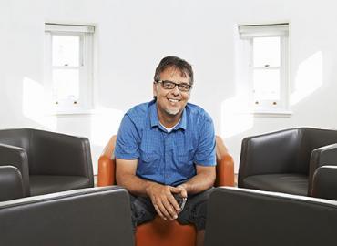 Ronald Deibert sitting on a couch