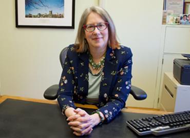 Sylvia Bashevkin sitting at her desk.