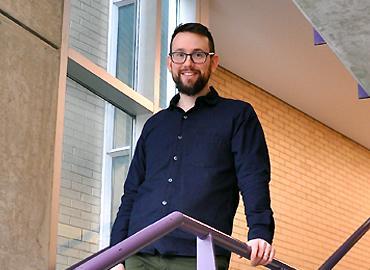 Tanhum Yoreh standing on the stairs.
