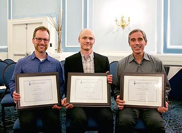 Erol Boran, Mark Taylor and Franco Taverna holding their awards