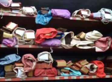 Colourful clothing of shelves.