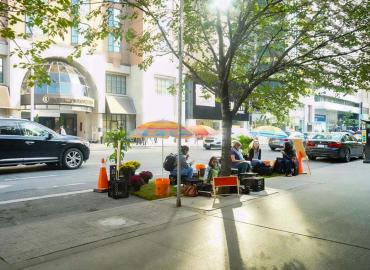 U of T students take over a parking space on Bloor Street West to mark PARKing Day, a global effort to draw attention to the need for public space