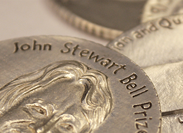 A coin that says John Stewart Bell Prize.
