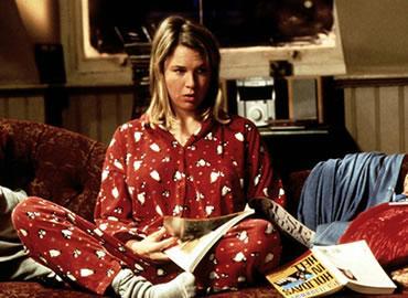 Bridget Jones in pyjamas on her bed