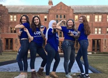 5 women posing with insulin pumps on the U of T campus
