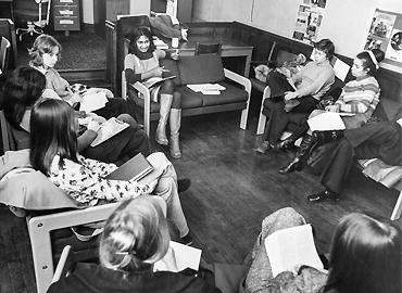 A group of people meeting in a room.