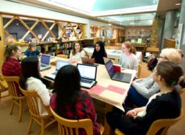 Deirdre Baker with her students at the Groundwood Archive at the Toronto Public Library's Osborne Collection.