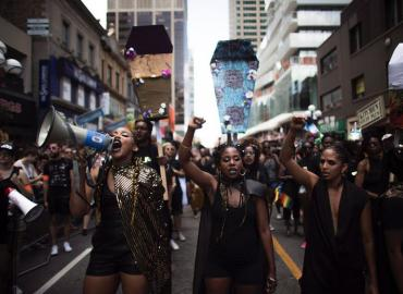 People from the Black Lives Matter lead the annual Pride Parade in Toronto on Sunday, July 3, 2016.